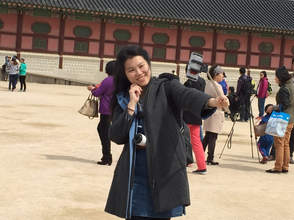 Gyeongbokgung Palace. A tourist with a selfie stick.