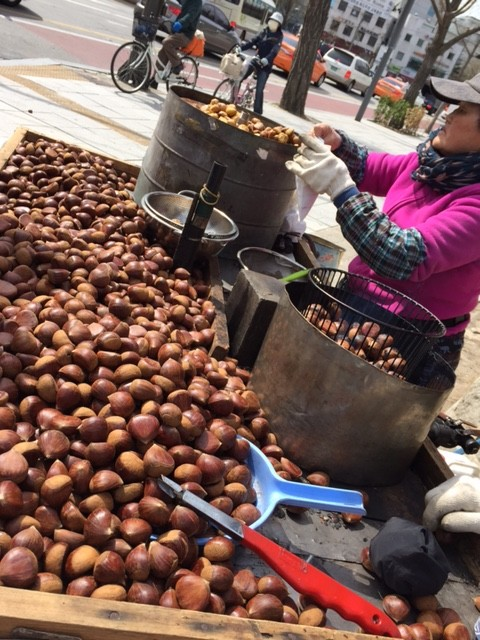 Warm chestnuts being roasted outside the palace gates