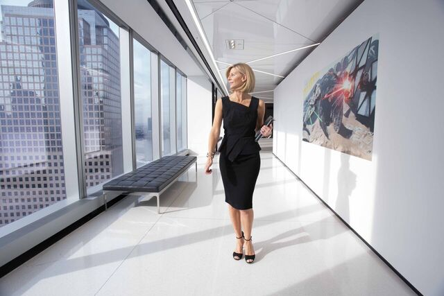 woman wearing black dress and walking in the in the office hallway for HOW TO CHANGE CAREERS