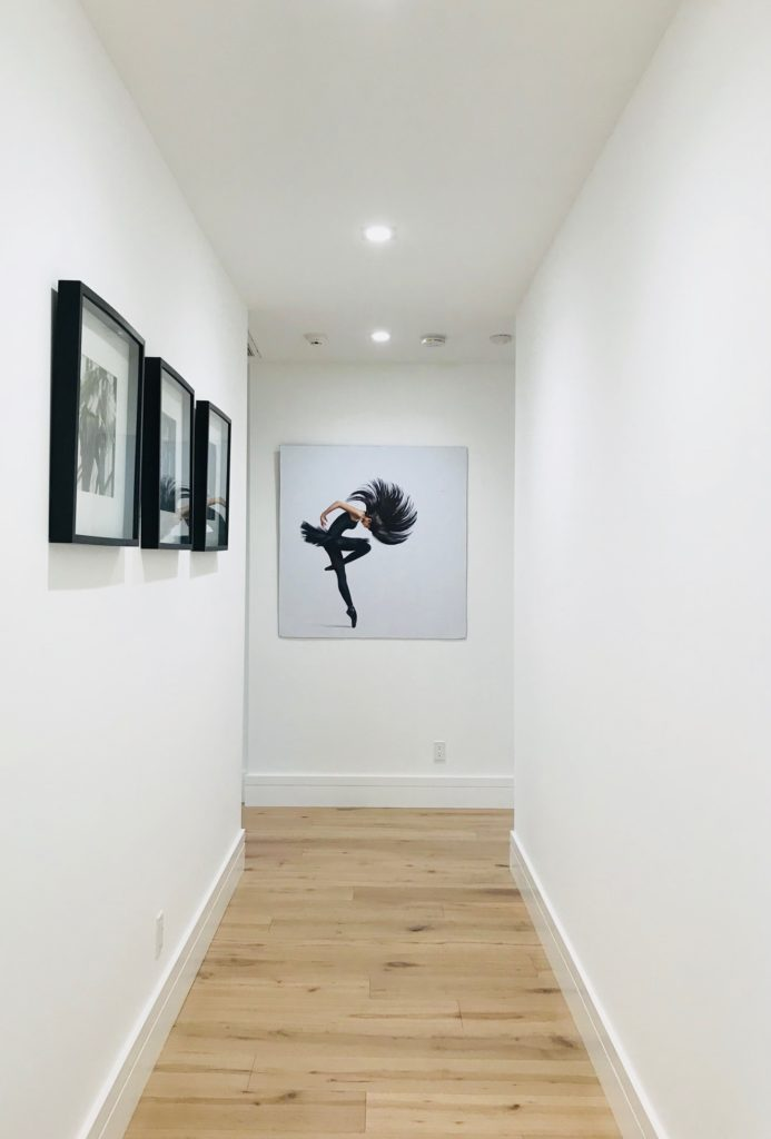 paintings on the wall of a hallway for feng shui during the holidays