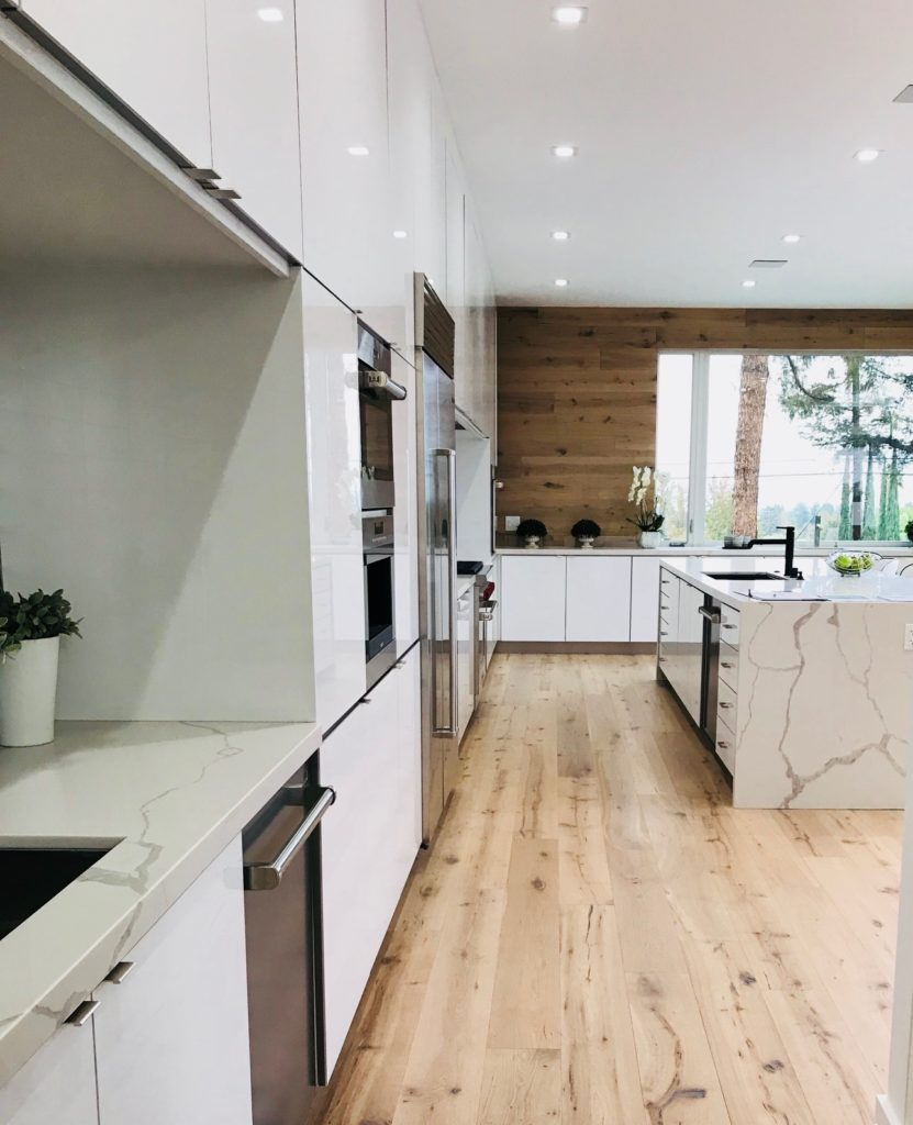 feng shui during the holidays on kitchen with white walls, white, island, and wooden floor