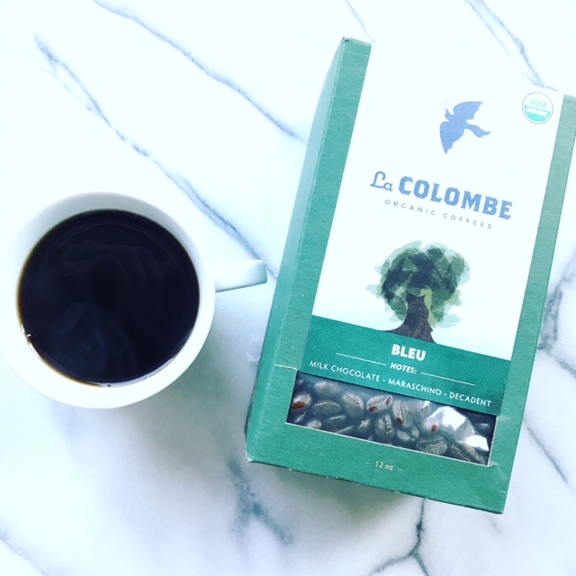 box of la colombe coffee and a mug with coffee for MORNING BEAUTY ROUTINE