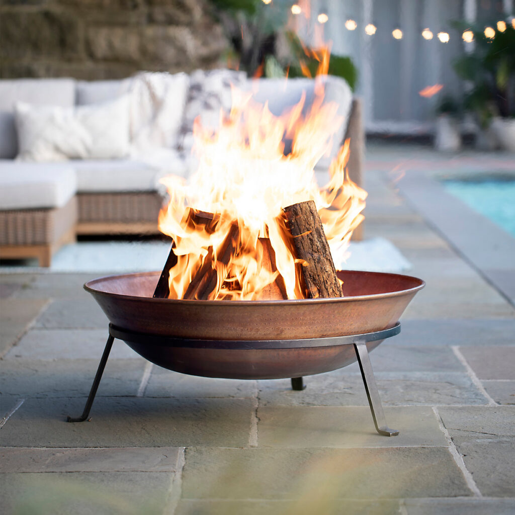 coper fire pit on the poolside for FATHER'S DAY GIFT GUIDE 2021