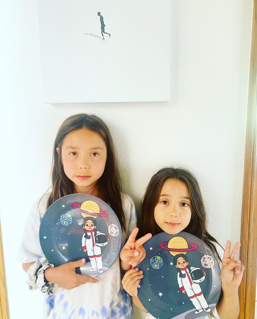two kids holding colorful plates for back to school essentials