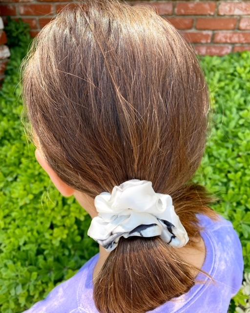 kid using satin scrunchies
