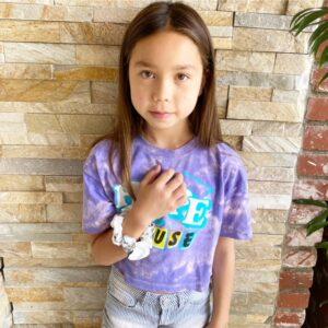 kid wearing satin scrunchies on her arm