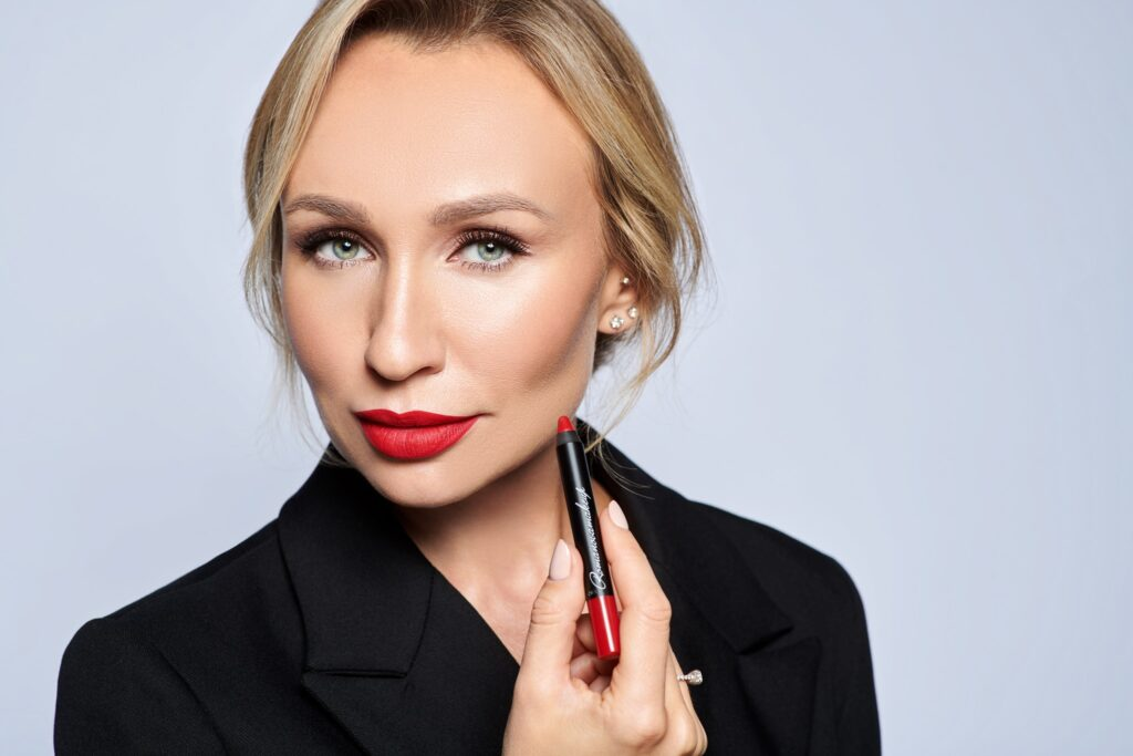 woman holding Romanova makeup