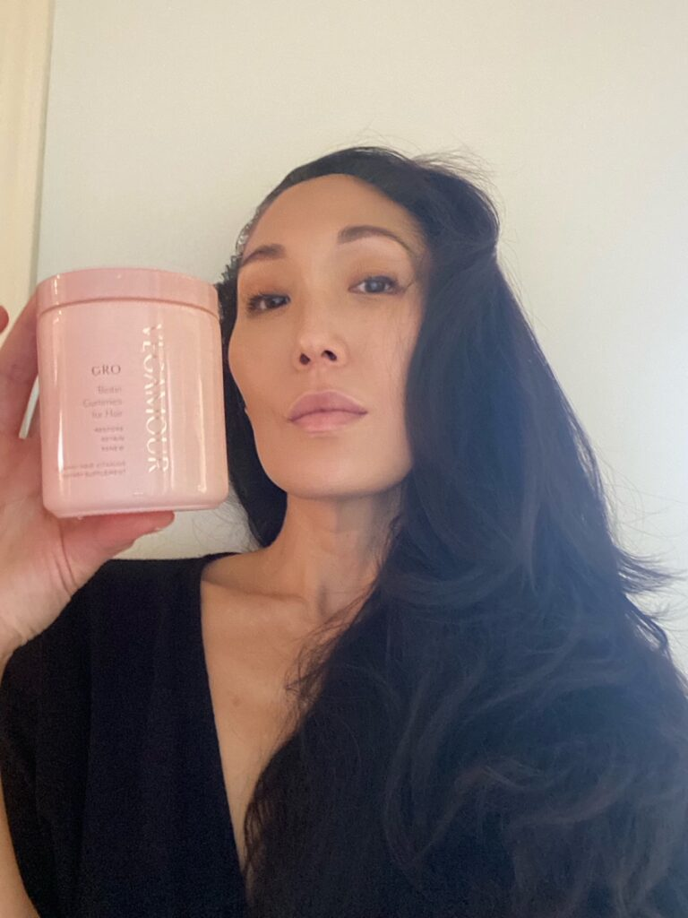 woman holding GRO from VEGAMOUR HAIRCARE